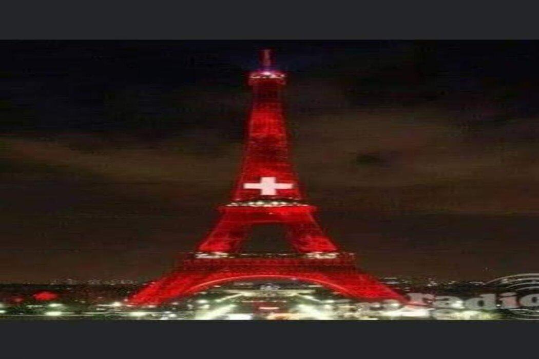 ادعاء اضاءة برج ايفل بعلم سويسرا